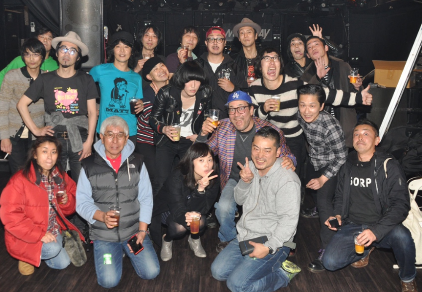 Staff poses for photo after DIY event in Tokyo on Jan. 26, 2015. That event holds the record for attendance at that club. Tatsuji Nobuhara is standing in the back with the aqua blue T-shirt. Immediately behind him is Ken Nishikawa. Mr. Pan is the guy standing in the back with the brown hat. I'm wearing the stupid Dodgers baseball cap. (Photo by Osamu Arai).